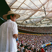 Olympic Games Athletics Day 11<br /> A chinese spectator is looking at athletics in the National Stadium<br /> A man is looking at the women's 200m race round 1 of the Olympic Games in the Bird's Nest, Beijing, August 19 2008 High Resolution available