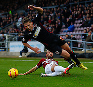 Picture by David Horn/Focus Images Ltd +44 7545 970036<br /> 16/11/2013<br /> Chris Hackett of Northampton Town fouls Charlie Taylor of Fleetwood Town during the Sky Bet League 2 match at Sixfields Stadium, Northampton.