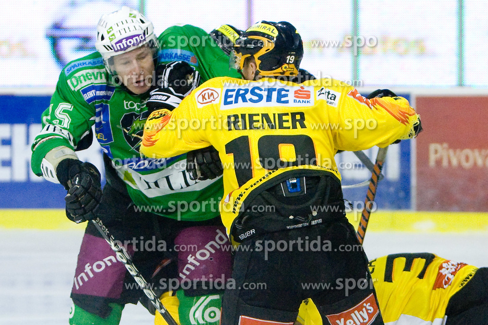 Egon Muric of Olimpija vs Youssef Riener of Vienna during 52nd Round of EBEL league ice-hockey match between HDD Tilia Olimpija, Ljubljana and EV Vienna Capitals, on February 7, 2010 in Arena Tivoli, Ljubljana, Slovenia. Vienna defeated Olimpija 8-2. (Photo by Vid Ponikvar / Sportida)