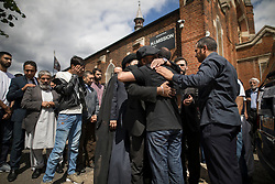 © Licensed to London News Pictures. 14/07/2017. London, UK. Mourners look on as brothers Bashir and Hamid are comforted after they carried the coffin of their father Mr Ali Jafari from the Hussaini Islamic Mission after funeral prayers. Mr Jafari, 82, was killed in the fire that destroyed Grenfell Tower in June. Photo credit: Peter Macdiarmid/LNP