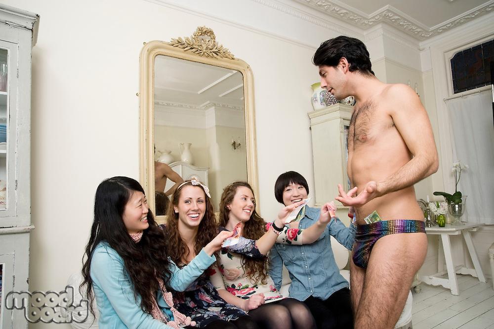 Women offering exotic dancer money
