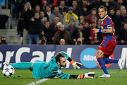 FC Barcelona's Daniel Alves (r) and Arsenal's Manuel Almunia during UEFA Champions League match.March 8,2011.
