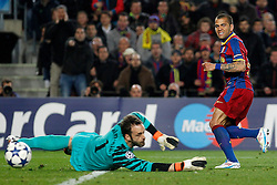 FC Barcelona's Daniel Alves (r) and Arsenal's Manuel Almunia during UEFA Champions League match.March 8,2011.