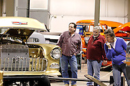(from right) Leslie Stuck, Benny Stokes and Mike Stuck, all of Beavercreek look at Ray & Darleena Thenot of Dayton's 1955 Chevrolet during the KOI Hot Rod Fest Dayton at the Dayton Airport Expo Center in Vandalia, Sunday, March 12, 2012.