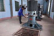 A Vietnamese worker operates a turbine in a pumping plant in Yen Mo District, Ninh Binh Province, Vietnam, Southeast Asia