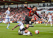 Chelsea Midfielder John Obi Mikel (12) tackles Bournemouth Forward Lewis Grabban (28) during the Barclays Premier League match between Bournemouth and Chelsea at the Goldsands Stadium, Bournemouth, England on 23 April 2016. Photo by Adam Rivers.