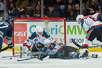 KELOWNA, CANADA - FEBRUARY 23: Brodan Salmond #31 defends the net as Gordie Ballhorn #4 of the Kelowna Rockets tries to block a shot by the Seattle Thunderbirds on February 23, 2018 at Prospera Place in Kelowna, British Columbia, Canada.  (Photo by Marissa Baecker/Shoot the Breeze)  *** Local Caption ***