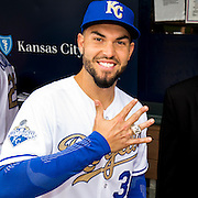 KANSAS CITY, MO - APRIL 5, 2016: Eric Hosmer #35 of the Kansas City Royals displays his 2015 World Series Championship ring in the dugout after receiving it during pre-game ceremonies before the game against the New York Mets at Kauffman Stadium on April 5, 2016 in Kansas City, Missouri. (Photo by Jean Fruth)