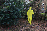 The silhouette sign of a running man in a public park in south London tells fitness fanatics the benefits of healthy exercise.