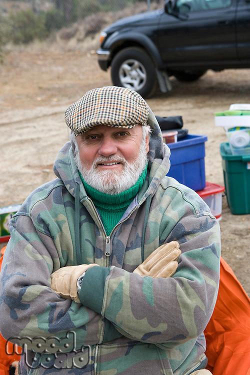 Senior man on camping trip, portrait