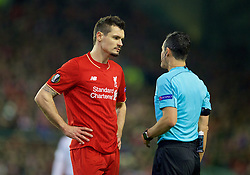 LIVERPOOL, ENGLAND - Thursday, March 10, 2016: Referee Carlos Velasco Carballo speaks to Dejan Lovren during the UEFA Europa League Round of 16 1st Leg match against Manchester United at Anfield. (Pic by David Rawcliffe/Propaganda)