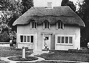 Princess Elizabeth (Elizabeth II of Great Britain from 1952) as a child on the steps of Y Bwthn Bach (The Little House) the play house given by the people of Wales