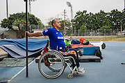 "2016/03/07 – Medellin, Colombia: Joe Gonzalez Bettencourt, 38, warms up before the practice of weight throwing at Atanasio Girardot Stadium, Medellin, 7th March, 2016. <br /> -<br /> Joe was a teenager when a paramilitary group approached him and his friends to become part of the Bloque Cacique Nutibara gang by starting to steal and kill. Joe and his friends refused because they didn't like violence and were more interested in party and living a life like any other normal teenager. But that refuse came with a high price. Joe and his best friend were chased on motorbike and the gang shot them. Joe was hit twice, one bullet hit his neck and another bullet hit his abdomen leaving through the lower back, making him paraplegic. His friend died. <br /> At the time of the incident, Joe was trying to become a football player, so sports were always part of his life. When he understood that he would be on a wheel chair he took on sports to keep going with his life. He started to play basketball, then tennis and in both he was National Champion. It was through his wife, who also is a Paralympics athlete, that he became interested in weigh throwing and javelin. On Joe's second tournament he became national champion, a title that he still holds today. During his progression on the sport he reached 4th in the world. Joe qualified to the Rio 2016 Paralympic games, but due to quota places he might not be able to go, something that he feels is quite unfair after so much work. <br /> Asked about his feeling for the responsible people that shot him, he says, ""We must be peaceful, forgive, but never forget. I will never forget because everyday I have to sit on this chair"". (Eduardo Leal)"