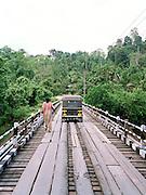 Tuk-tuk, 3-wheeled taxi crossing a bridge