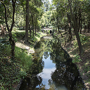 A small canal in the parkland in Basque de Chapultepec, a large and popular public park in the center of Mexico City.