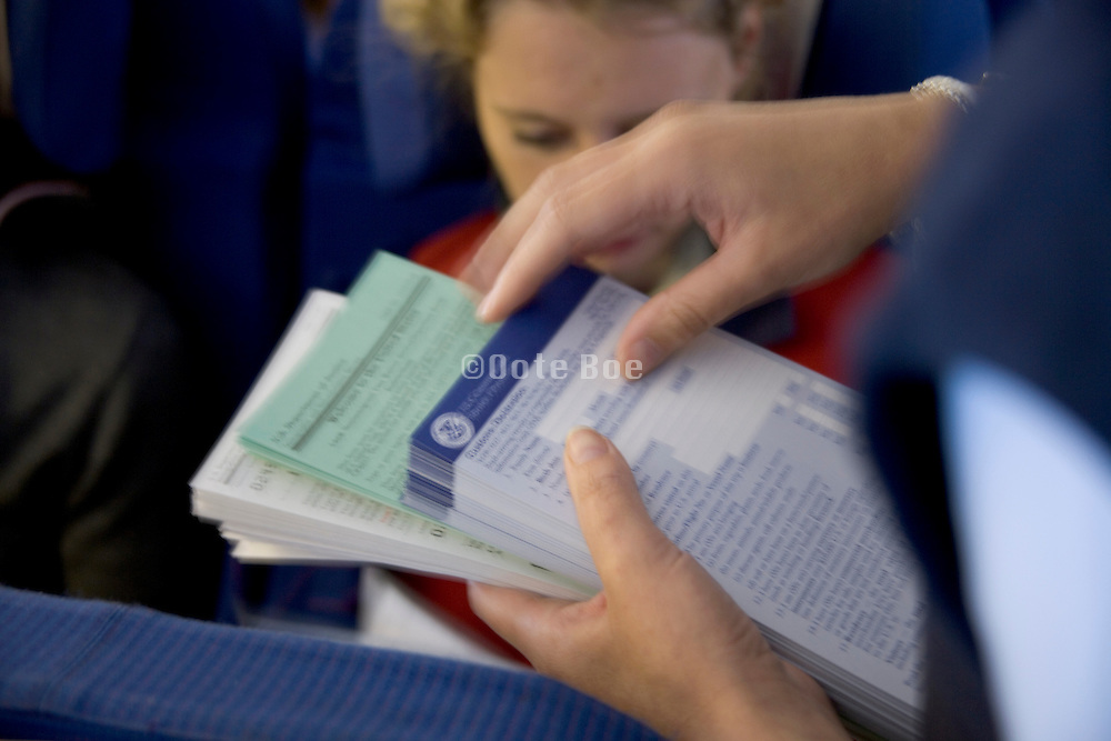 USA immigration visa and import forms being handed out in a airplane