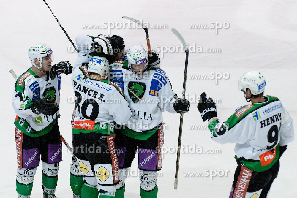 Team HDD Tilia Olimpija celebrate goal during ice-hockey match between HK Acroni Jesenice and HDD Tilia Olimpija in fourth game of Final at Slovenian National League, on April 8, 2011 at Dvorana Podmezaklja, Jesenice, Slovenia. (Photo By Matic Klansek Velej / Sportida.com)