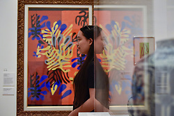 "© Licensed to London News Pictures. 01/08/2017. London, UK. A visitor is reflected against """"Mimosa"", 1949-51. Preview of ""Matisse in the Studio"", at the Royal Academy of Arts, Piccadilly, the first exhibition to consider how the personal collection of treasured objects of Henri Matisse were both subject matter and inspiration for his work.  Around 35 objects are displayed alongside 65 of Matisse's paintings, sculptures, drawings, prints and cut-outs.  The exhibition runs 5 August to 12 November 2017.  Photo credit : Stephen Chung/LNP"