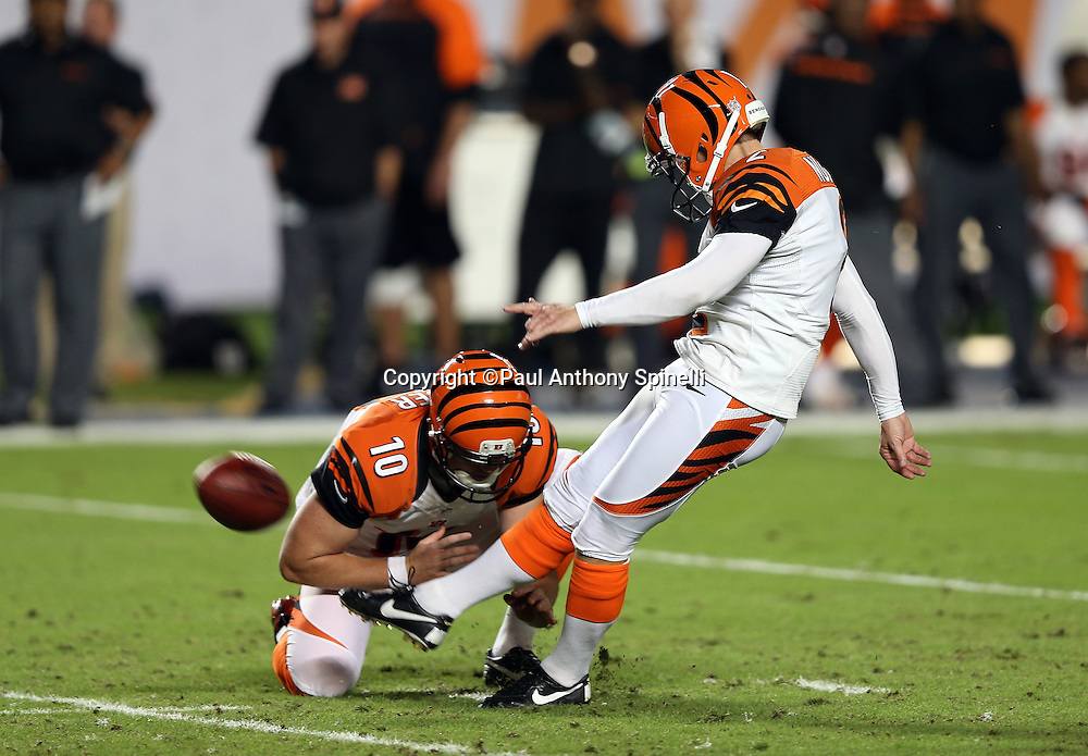 Cincinnati Bengals kicker Mike Nugent (2) kicks a field goal that gives the Bengals a 3-0 second quarter lead during the NFL week 9 football game against the Miami Dolphins on Thursday, Oct. 31, 2013 in Miami Gardens, Fla.. The Dolphins won the game 22-20 in overtime. ©Paul Anthony Spinelli