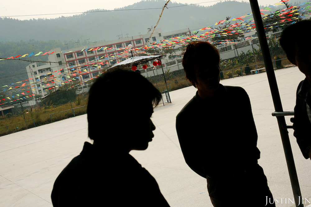 Farmers protesting land seizure at their village in Lishan, Guangdong province, in southern China. Industrial boom has led many local officials to sell off farmers' land to build factories, leaving farmers with little to survive on.