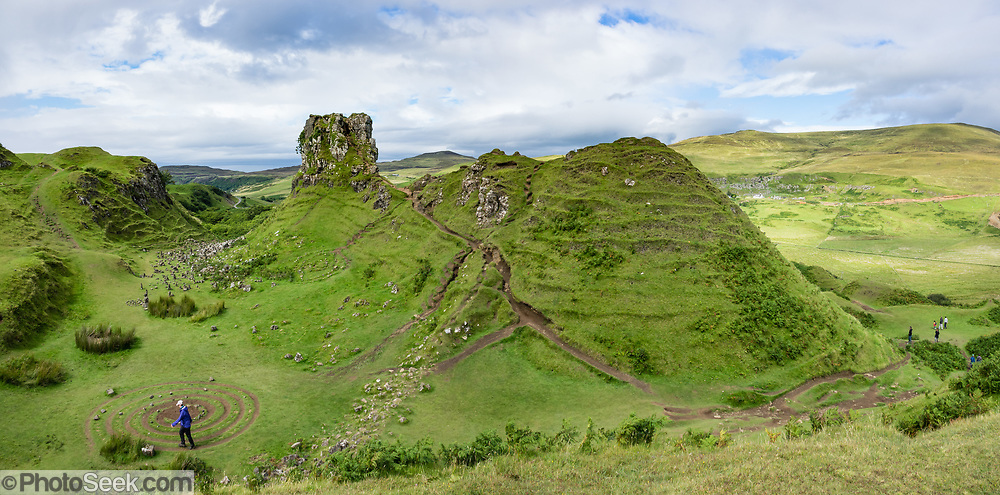 The Fairy Glen (or Faerie Glen) is an unusual landscape of grassy, cone-shaped hills, with Castle Ewen most prominent, near Uig village, on the Trotternish peninsula, in Scotland, United Kingdom, Europe. Walk an easy loop of 1.2 miles round trip (see www.walkhighlands.co.uk). This image was stitched from several overlapping photos.