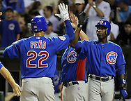 CHICAGO - JUNE 20:  Carlos Pena #22 celebrates with Alfonso Soriano #12 of the Chicago Cubs after Pena hit a three-run home run in the sixth inning against the Chicago White Sox on June 20, 2011 at U.S. Cellular Field in Chicago, Illinois.  The Cubs defeated the White Sox 6-3.  (Photo by Ron Vesely)  Subject:  Carlos Pena;Alfonso Soriano