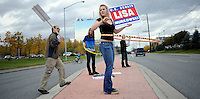 ANCHORAGE, AK- October 3:  Lisa Murkowski supporters wave signs and hoola hoop along an Anchorage street  at a  Alaskans for Lisa Rally.... Senator Lisa Murkowski (R-AK) campaigns as a write-in candidate to be re elected to Alaska's Senate seat in Anchorage, Alaska, Sunday, October 3, 2010. Joe Miller narrowly defeated incumbent Senator Lisa Murkowski in the republican primary. (Melina Mara/The Washington Post)