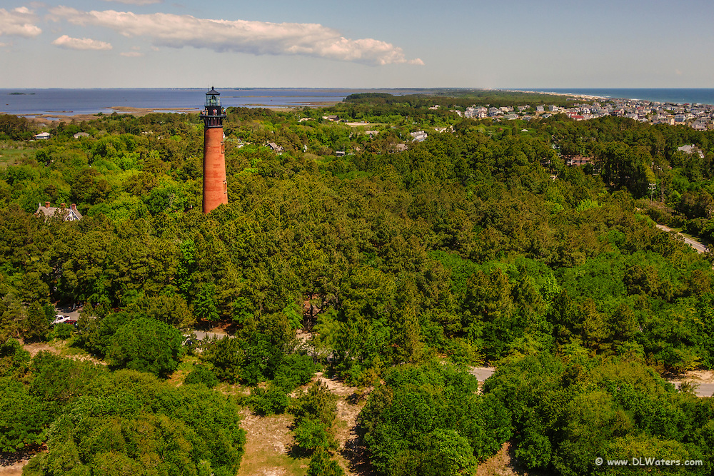 Currituck Beach Lighthouse in Corolla, NC on the Outer Banks captured from the air.