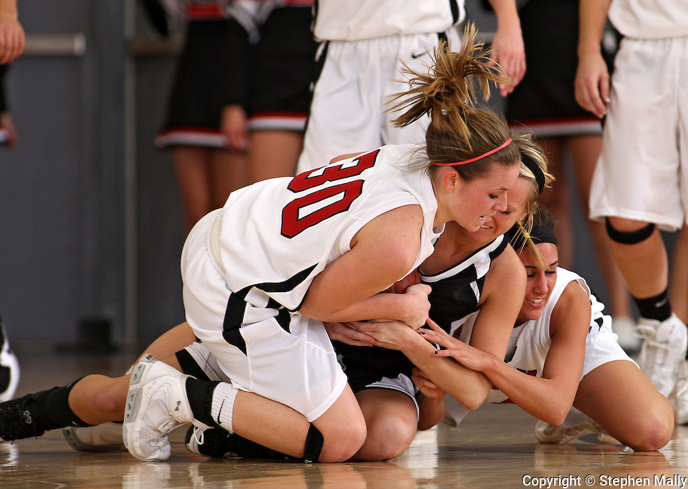 Linn-Mar's Jenna Eells (30), Waterloo West's Sarah Sand (13), and Linn-Mar's Kiley Haines (4) battle for a lose ball during their game at Linn-Mar High School in Marion on Tuesday January 5, 2010. Linn-Mar defeated Waterloo West 56-32. (Stephen Mally/Freelance)