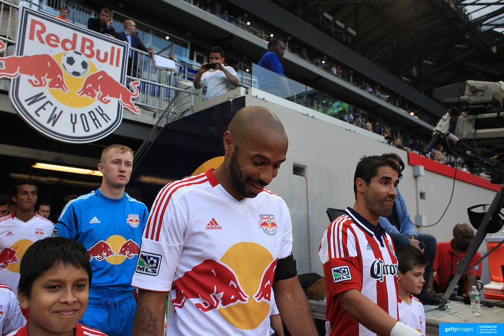 New York Red Bulls captain Thierry Henry (left) and Chivas USA captain Juan Pablo Angel lead their teams out before the New York Red Bulls V Chivas USA Major League Soccer match at Red Bull Arena, Harrison, New Jersey, 23rd May 2012. Photo Tim Clayton