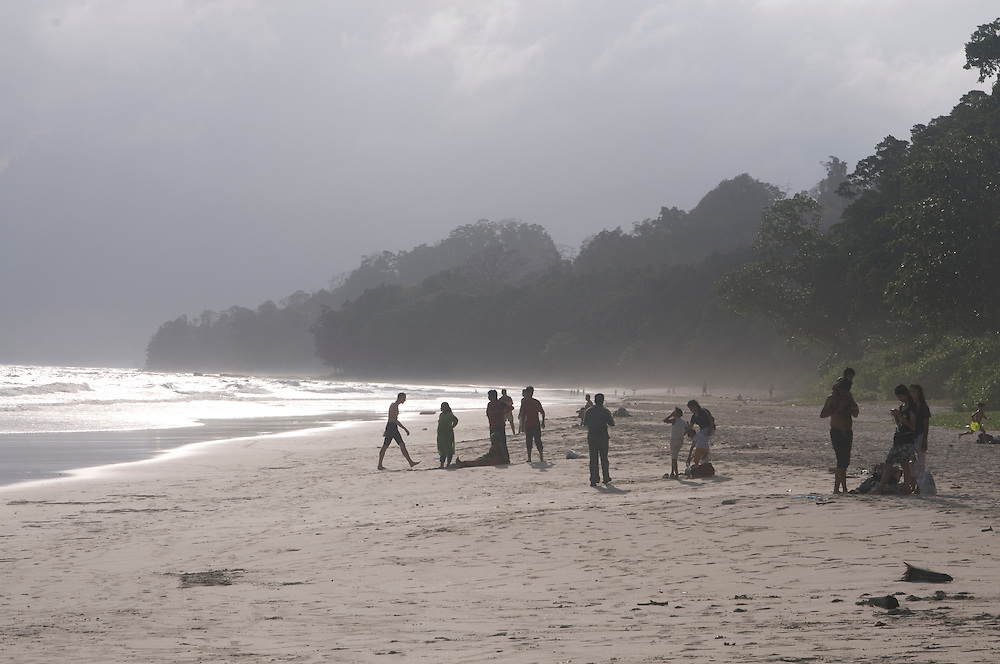 Sand beach and Indian Ocean with people. Havelock Island. Andaman Isles. India.