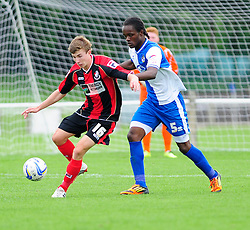 Bristol Rovers' U18s Trey Anderson puts pressure on the Bournemouth Attacker  - Photo mandatory by-line: Dougie Allward/JMP - Tel: Mobile: 07966 386802 17/08/2013 - SPORT - FOOTBALL - Bristol Rovers Training Ground - Friends Life Sports Ground - Bristol - Academy - Under 18s - Youth - Bristol Rovers U18s V Bournemouth U18s