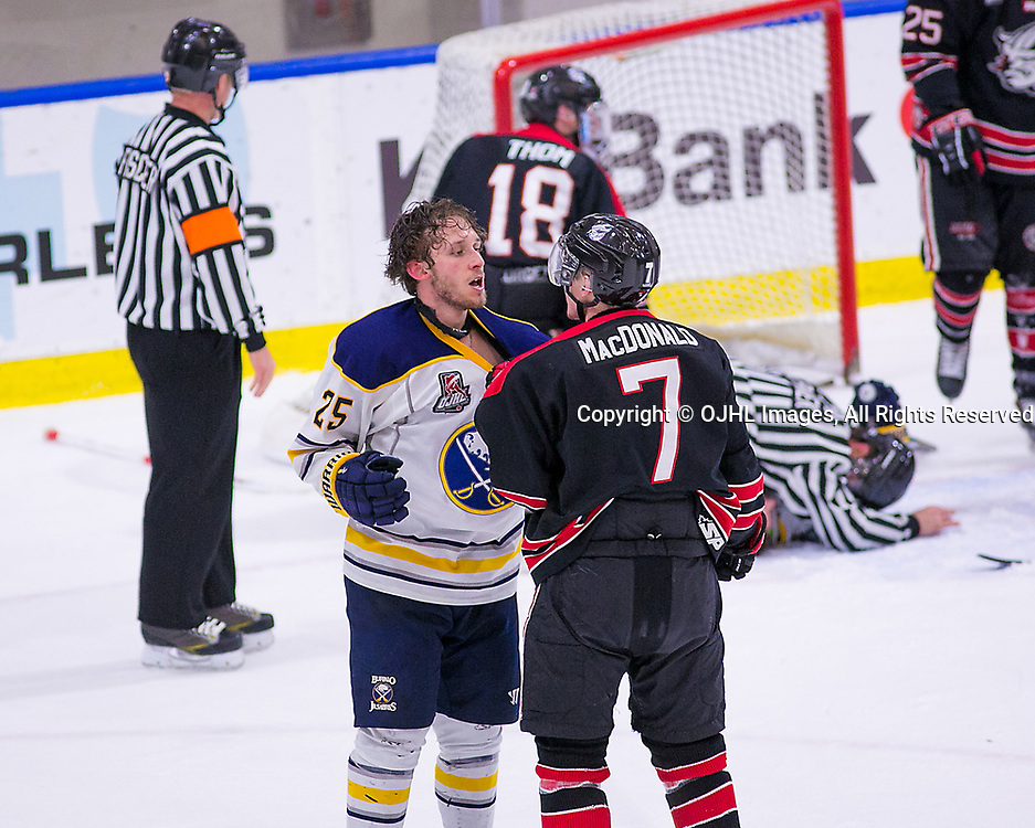 Buffalo, New York March 6,  2017: Ontario Junior Hockey League, playoff game between the Georgetown Raiders and the Buffalo Jr Sabres.}, Ryan Cox #25 of the Buffalo Jr. Sabres and Arran MacDonald #7 of the Georgetown Raiders have a few words together during the second period.<br /> <br /> (Photo by Deb McGwin / OJHL Images)