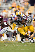 Baton Rouge, LA - SEPTEMBER 30:  Dwayne Bowe #80 of the LSU Tigers runs with the ball against the Mississippi State Bulldogs at Tiger Stadium on September 30, 2006 in Baton Rouge, Louisiana.  The Tigers defeated the Bulldogs 48 - 17.  (Photo by Wesley Hitt/Getty Images) *** Local Caption *** Dwayne Bowe