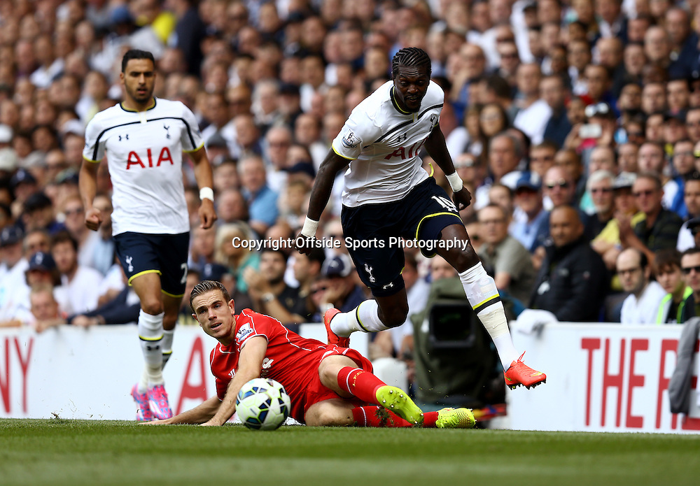 31 August 2014 - Barclays Premier League - Tottenham Hotspur v Liverpool - Emmanuel Adebayor of Tottenham Hotspur in action with Jordan Henderson of Liverpool - Photo: Marc Atkins / Offside.