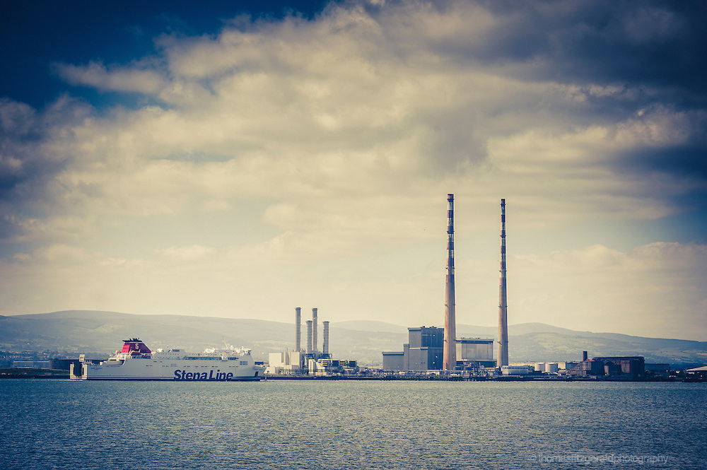 A Stena Line ferry approaches the port of Dublin in Dublin city. In the background is the Poolbeg Power station at the Pigen house. Taken from Bull Island in Clontarf in the North of Dublin City.