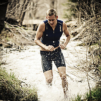 Wesley Johnson: USAT Level 1 Coach, Elite Age Group Triathlete, and a founding member of the Trifecta Endurance LLC team running through creek in Millcreek Canyon, Utah