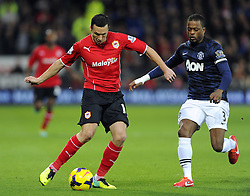 Cardiff City Midfielder, Jordon Mutch (ENG) battles for the ball with Man Utd Defender Patrice Evra (FRA) - Photo mandatory by-line: Joseph Meredith/JMP - Tel: Mobile: 07966 386802 - 24/11/2013 - SPORT - FOOTBALL - Cardiff City Stadium - Cardiff City v Manchester United - Barclays Premier League.