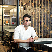 April 11, 2015 - New York, NY : Owner George Mendes poses for a portrait in the dining room of his soon-to-open Portuguese restaurant Lupulo, at 835 6th Ave. in Manhattan, on Saturday afternoon.  CREDIT: Karsten Moran for The New York Times