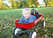 Portrait of child in a red wagon, Longmont.  Family pictures for holiday card.  Fall photos of family.