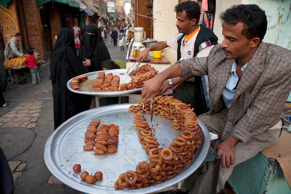 Vendors sell sweets and pastries on the narrow streets of the old souk in Sanaa, the capital of Yemen.