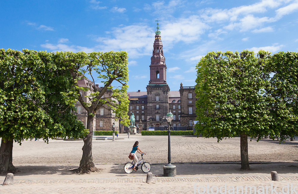 Christiansborg Palace (Danish: Christiansborg Slot; pronounced [krɪsdj&aelig;nsˈbɔːɐ̯ˀ]), on the island of Slotsholmen in central Copenhagen, is the seat of the Danish Parliament, the Danish Prime Minister's Office and the Danish Supreme Court. Also, several parts of the palace are used by the monarchy, including the Royal Reception Rooms, the Palace Chapel and the Royal Stables.<br /> The palace is thus the house of Denmark's three supreme powers: the executive power, the legislative power, and the judicial power. It is the only building in the world that houses all three of a country's branches of government. Christiansborg Palace is owned by the Danish state, and is run by the Palaces and Properties Agency.