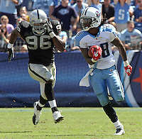 September 12,2010: Tennessee Titans running back Chris Johnson (28) runs away from Oakland Raiders linebacker Kamerion Wimbley (96) for a 76 yard touchdown run at LP Field in Nashville, Tennessee. The Titans defeated the Raiders 38 to 13.