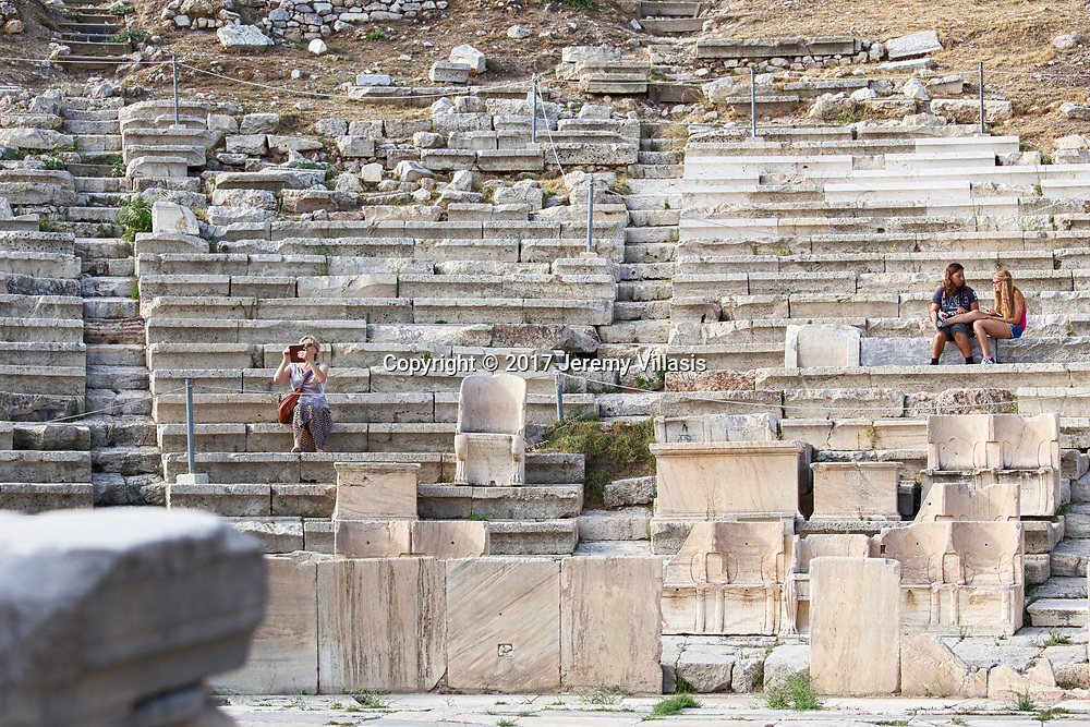 Cut into the southern cliff face of the Acropolis, the 4th-century BC Theatre of Dionysus is the first theatre ever built and supposedly birthplace of Greek tragedy. The great Greek tragedies of Sophocles and Euripides were performed here.<br /> <br /> The theatre was dedicated to Dionysus, the god of wine and plays and could seat as many as 17,000 people.