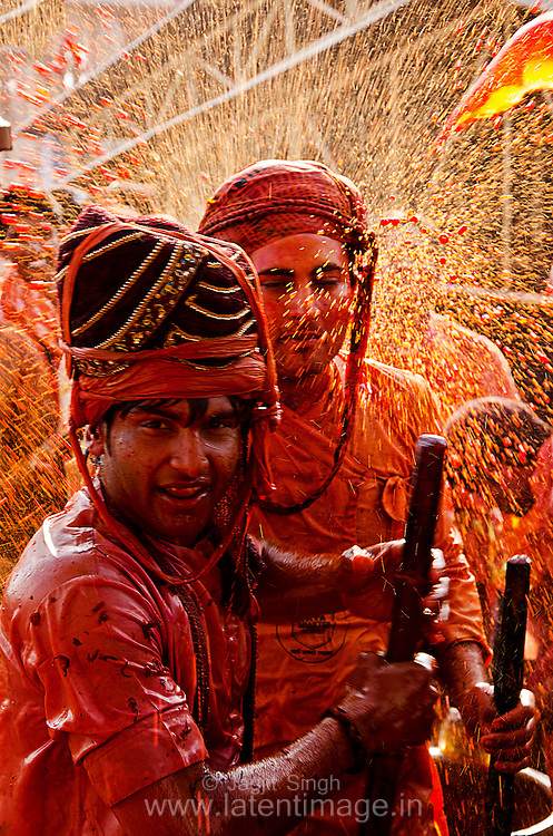 People from Nandgaon are greeted with the splash of water color. Braj ki Holi