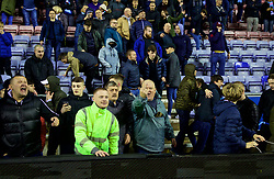 WIGAN, ENGLAND - Monday, February 19, 2018: Manchester City supporters rip up advertising hoardings to throw at the opposition supporters after their side's 1-0 defeat during the FA Cup 5th Round match between Wigan Athletic FC and Manchester City FC at the DW Stadium. (Pic by David Rawcliffe/Propaganda)