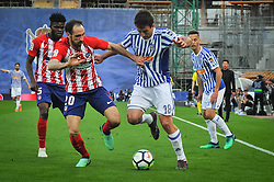 April 19, 2018 - San Sebastian, Spain - Juanfran of Atletico Madrid duels for the ball with Oyarzabal of Real Sociedad during the Spanish league football match between Real Sociedad and Atletico Madrid at the Anoeta Stadium on 19 April 2018 in San Sebastian, Spain  (Credit Image: © Jose Ignacio Unanue/NurPhoto via ZUMA Press)