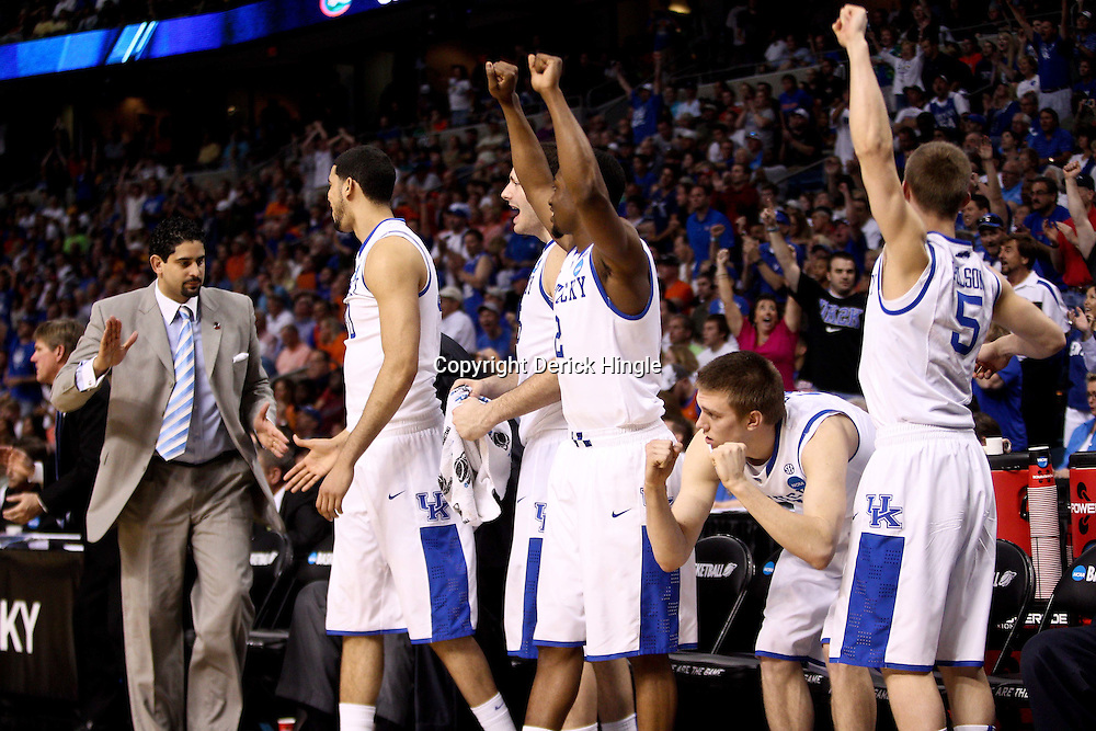 Mar 19, 2011; Tampa, FL, USA; The Kentucky Wildcats bench celebrates as the buzzer sounds on a win over the West Virginia Mountaineers in the third round of the 2011 NCAA men's basketball tournament at the St. Pete Times Forum. Kentucky defeated West Virginia 71-63.  Mandatory Credit: Derick E. Hingle