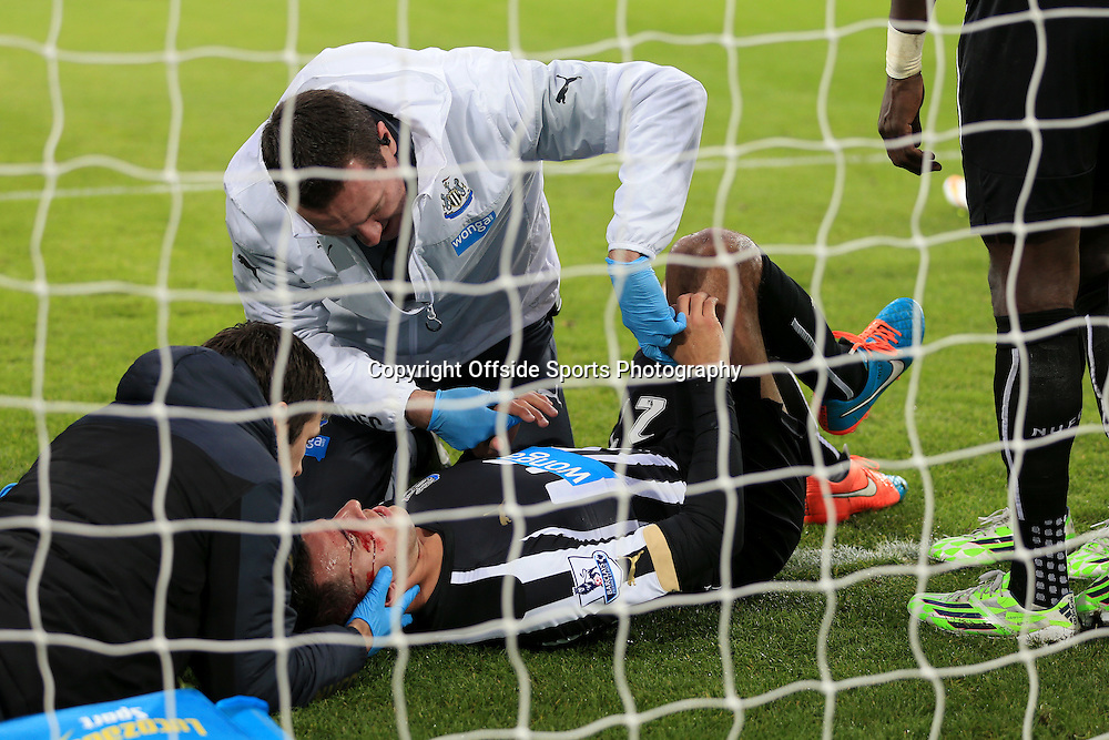 21st December 2014 - Barclays Premier League - Newcastle United v Sunderland - Medics tend to Steven Taylor of Newcastle as he lies injured with a bloody cut to his face - Photo: Simon Stacpoole / Offside.