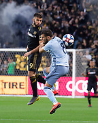 LAFC forward Diego Rossi (9) and Sporting KC midfielder Graham Zusi (8) attack the ball during a MLS soccer match in Los Angeles, Sunday, March 3, 2019. LAFC defeated Sporting KC, 2-1. (Ed Ruvalcaba/Image of Sport)